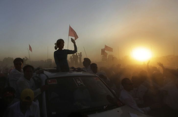 Feb. 26, 2012. Myanmar's pro-democracy icon Aung San Suu Kyi is silhouetted against the setting sun.