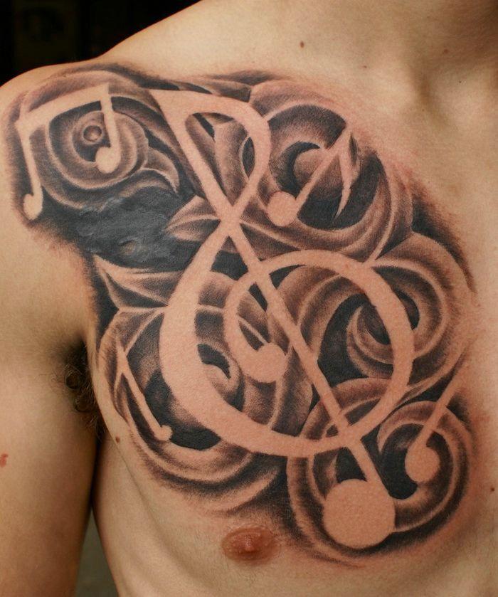 Tribal Music Tattoo On Men Chest Tattoo Designs Pattern Music Tattoo Designs Chest Piece Tattoos Music Notes Tattoo