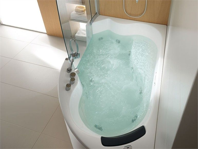 Bathtub idea. would solve my desire to have jetted tub with shower for small space