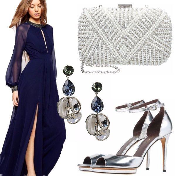 Look prezioso per una serata elegante o una cerimonia composto da abito  lungo blu notte con maniche lunghe e decori sul collo e polsi. b8b4a87c357