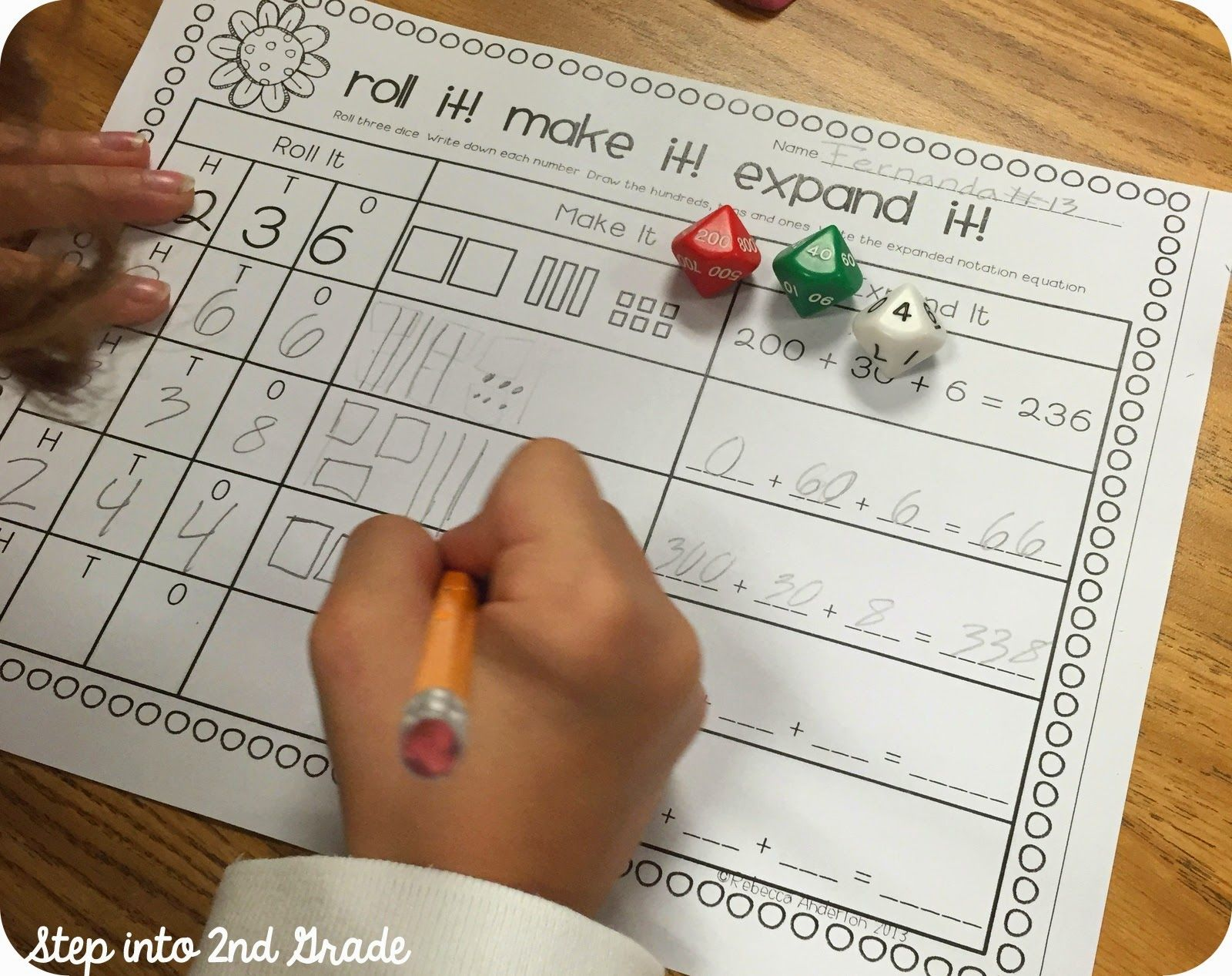 Place Value Dice Activity - I might also add a column for writing the value of each digit like 2 hundreds, 3 tens 6 ones.