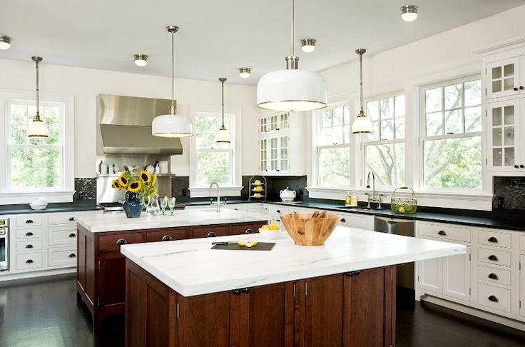 Gorgeous galley kitchen with modern white kitchen cabinets, twin