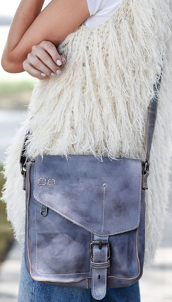 b0345c6cb57 Bring color to your outfit with a blue handmade leather BEDSTU crossbody bag.  style with a shaggy styled white vest and light washed denim.