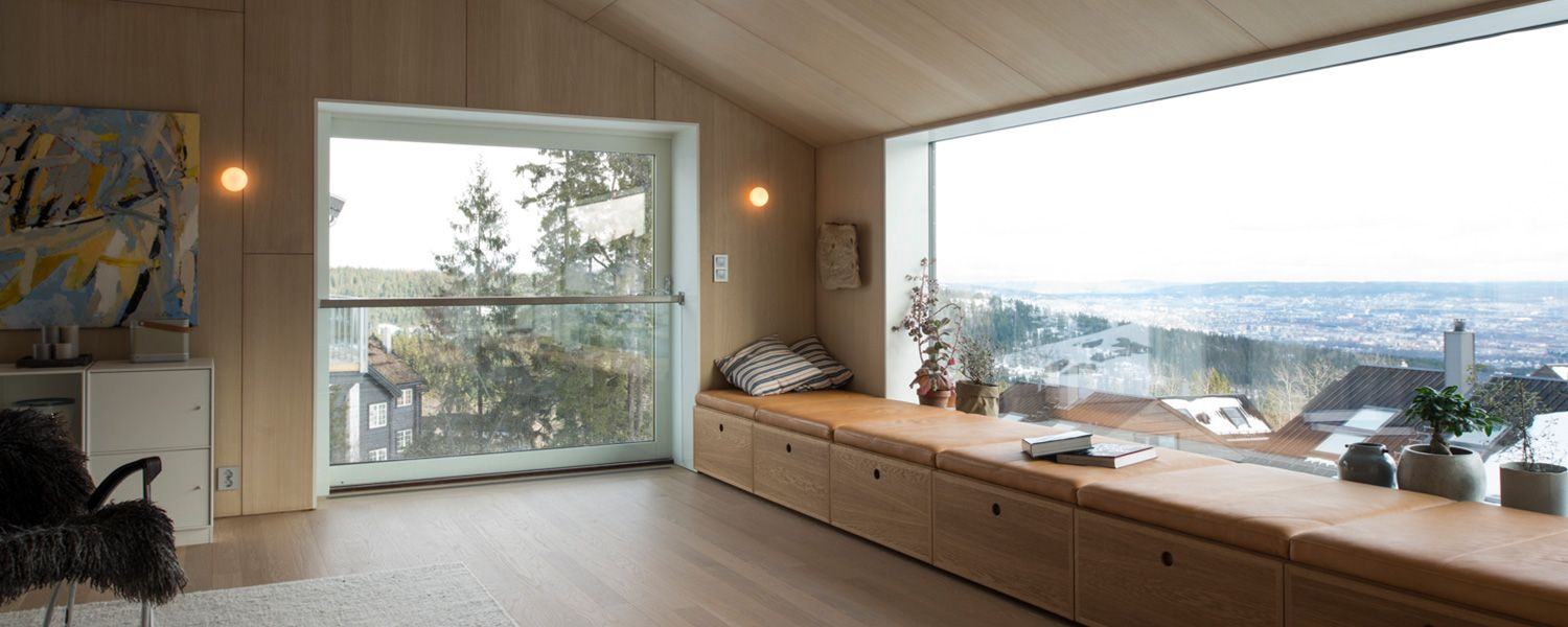 The single family house is built on the very edge of the Oslo city limits with miles of dense forest behind it. It also means that the site is situated at the highest point over the city with a formidable view over the urban landscape, the fjords and hills in the distant horizon.
