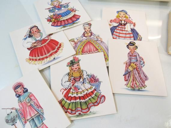 Dolls of Many Lands Correspondence Cards - International Dolls - All Different - 16 Doll Cards with EnvelopesThe artistry of these cards is exceptional. Each international doll card is different, in a multitude of bright colors an on high quality folded paper. Dolls include: Sweden, America, Germany, Mexico, Japan, Holland, China, Egypt, Eskimo, Scotland, Spain, Switzerland, Indian (American), India, Latin America, Ireland.16 of the 18 cards are in the box, with envelopes. Cards are in gorgeous