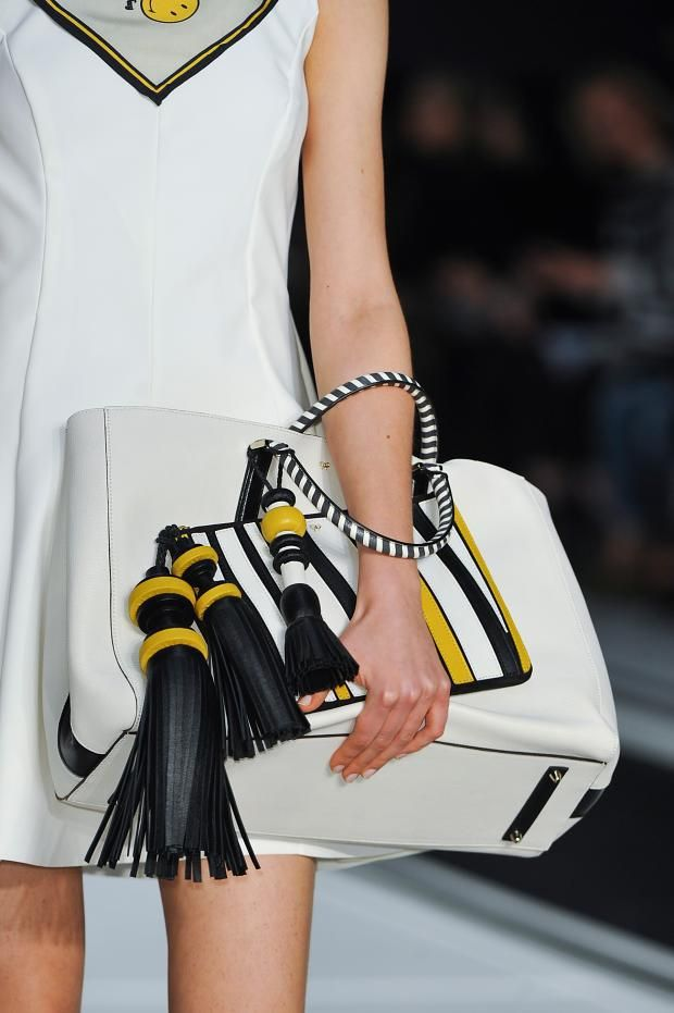 View all the detailed photos of the Anya Hindmarch autumn (fall) / winter 2014 showing at London fashion week.  Read the article to see the full gallery.
