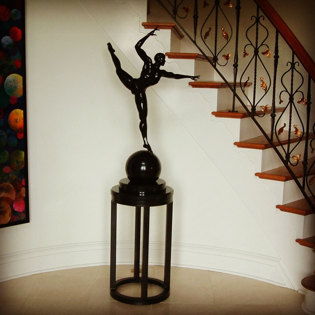 Display pedestal and stair rail designed and executed by Maurice Beane Studios. #ironrailings #rva #goldleaf #customrailings #ornamentaliron