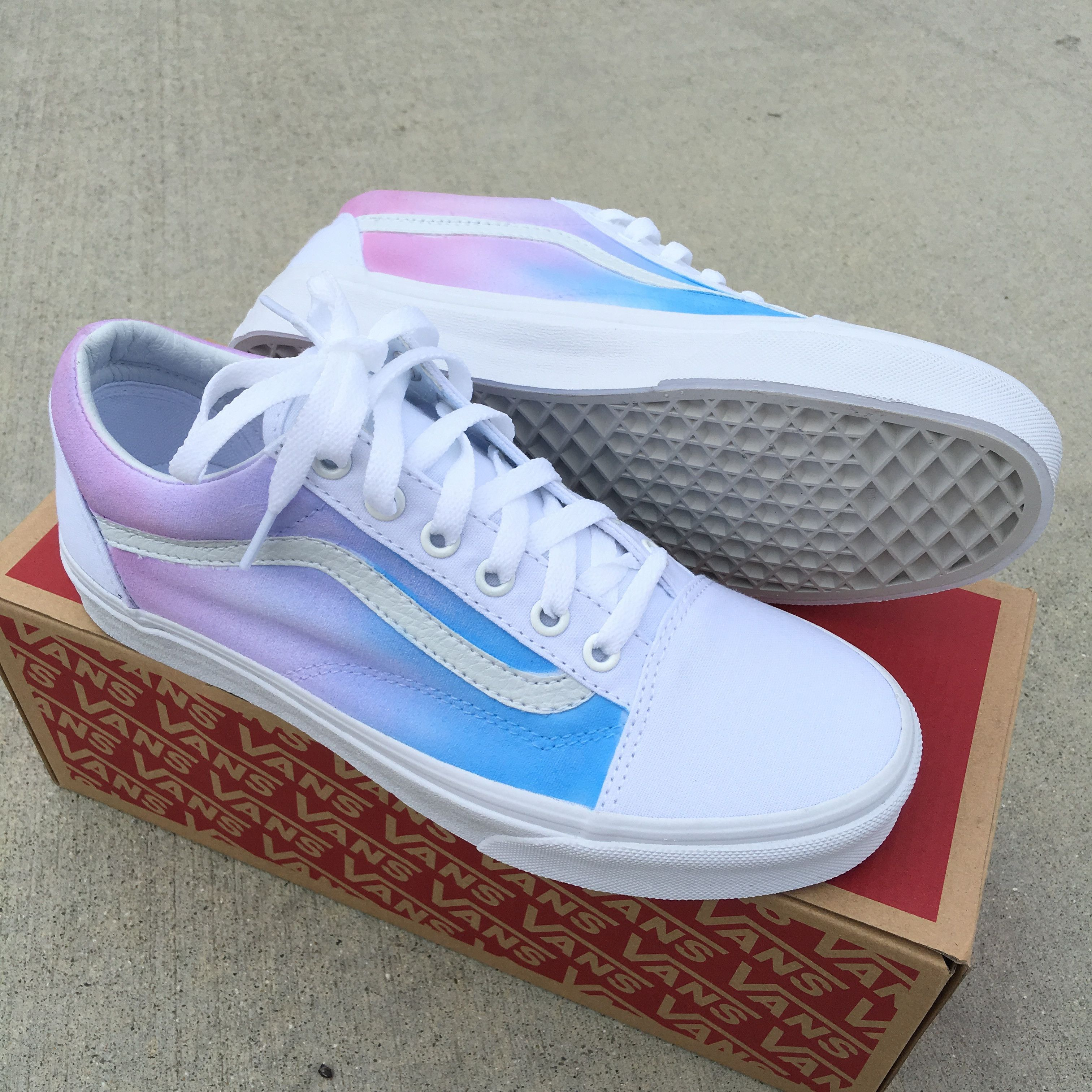570caf23da These True White Vans Old Skool Sneakers have been painted with a pastel  color ombre gradient on the sides of the shoes. The light blue color starts  towards ...