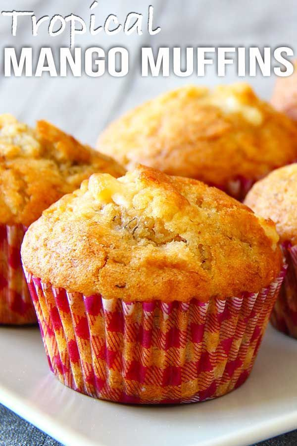 Tropical Mango Muffins Fluffy moist tropical mango muffins with combinations of mango, banana, coconut and white chocolate..one muffin can't get more tropical than that!