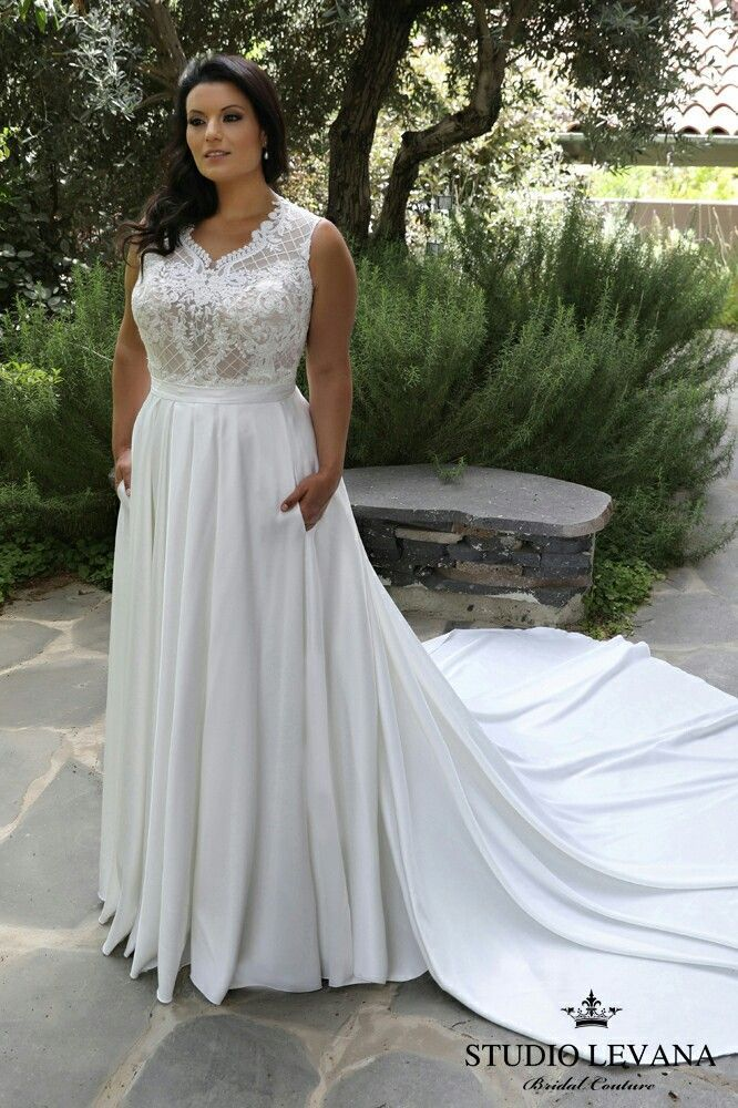 Curvy and modest in this plus size wedding gown Paola # ...