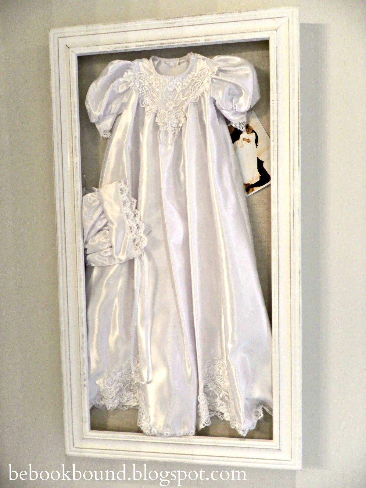 frame my littles girls christening gown and cap with a photo of her wearing it to hang on the wall for sweet sentimental art also a good way to preserve