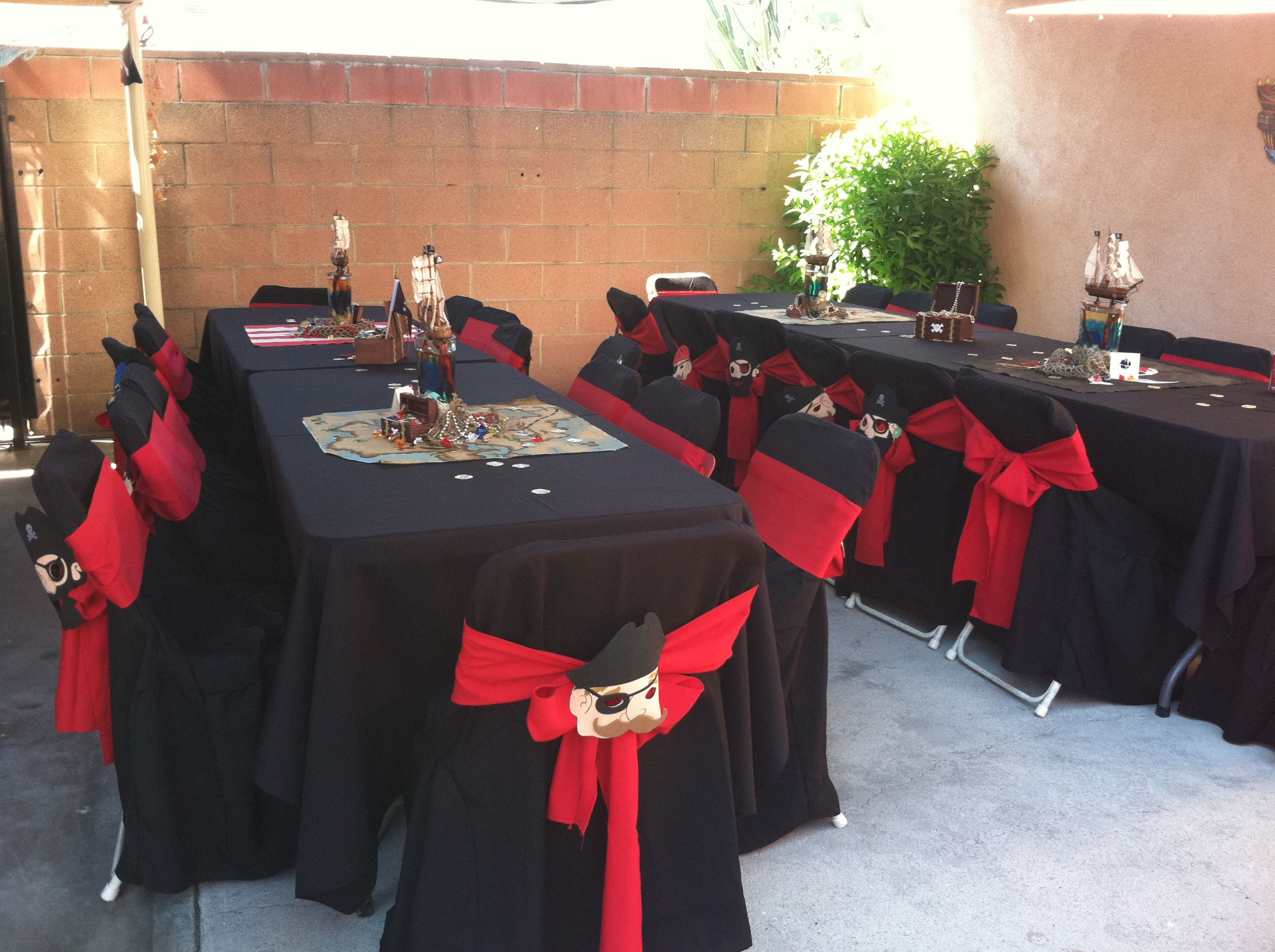 pirate party decoration black table cloth black chair covers with red bow and foamie pirate. Black Bedroom Furniture Sets. Home Design Ideas