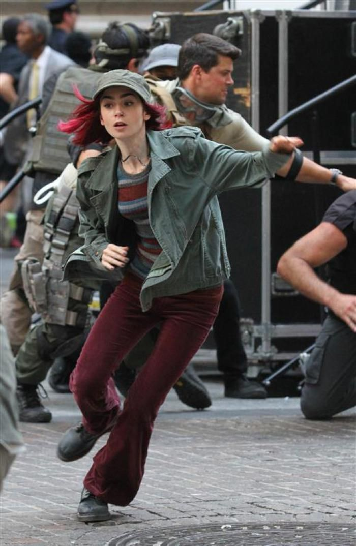 With how many times they've broken up and gotten back together, this could be Lily Collins running to or from Jamie Campbell Bower.