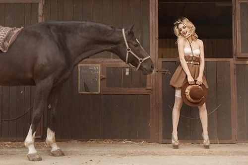 fashionable cowgirl and her horse
