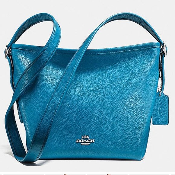 Coach Duffelette Purse Brand new // never carried // wear as crossbody or on shoulder // big wide inside // has dust bag // if you would like more pictures msg me  Coach Bags