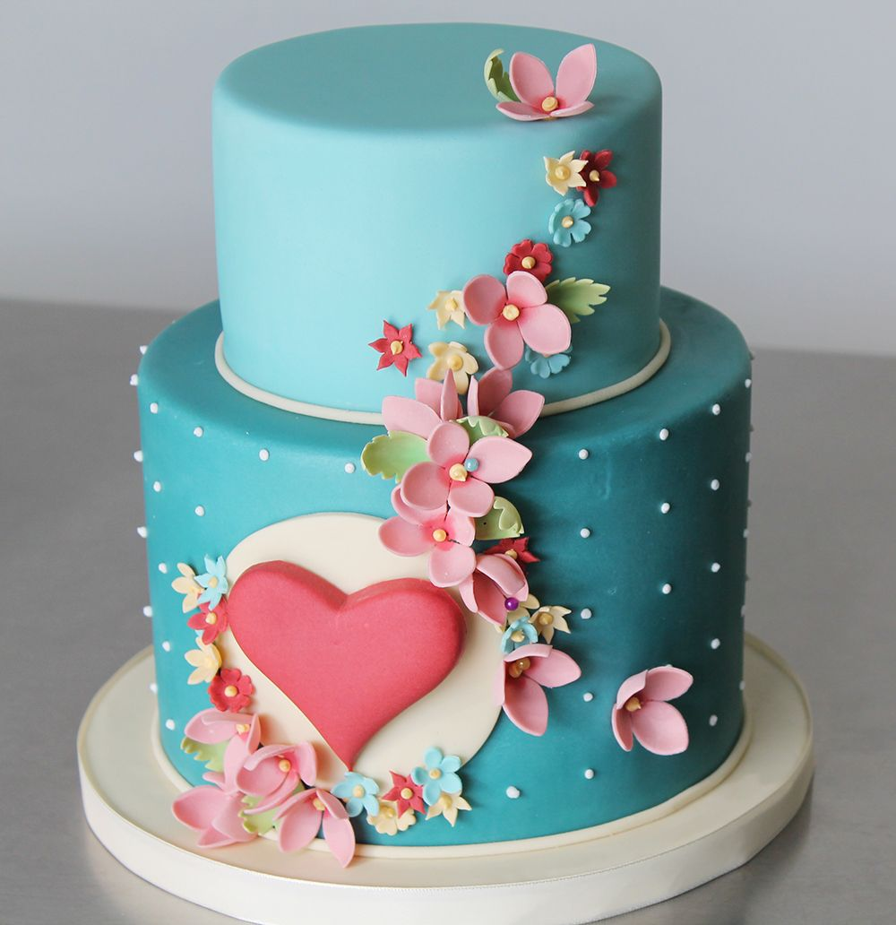 Gorgeous twotiered cake by a recent designer cake graduate cakes