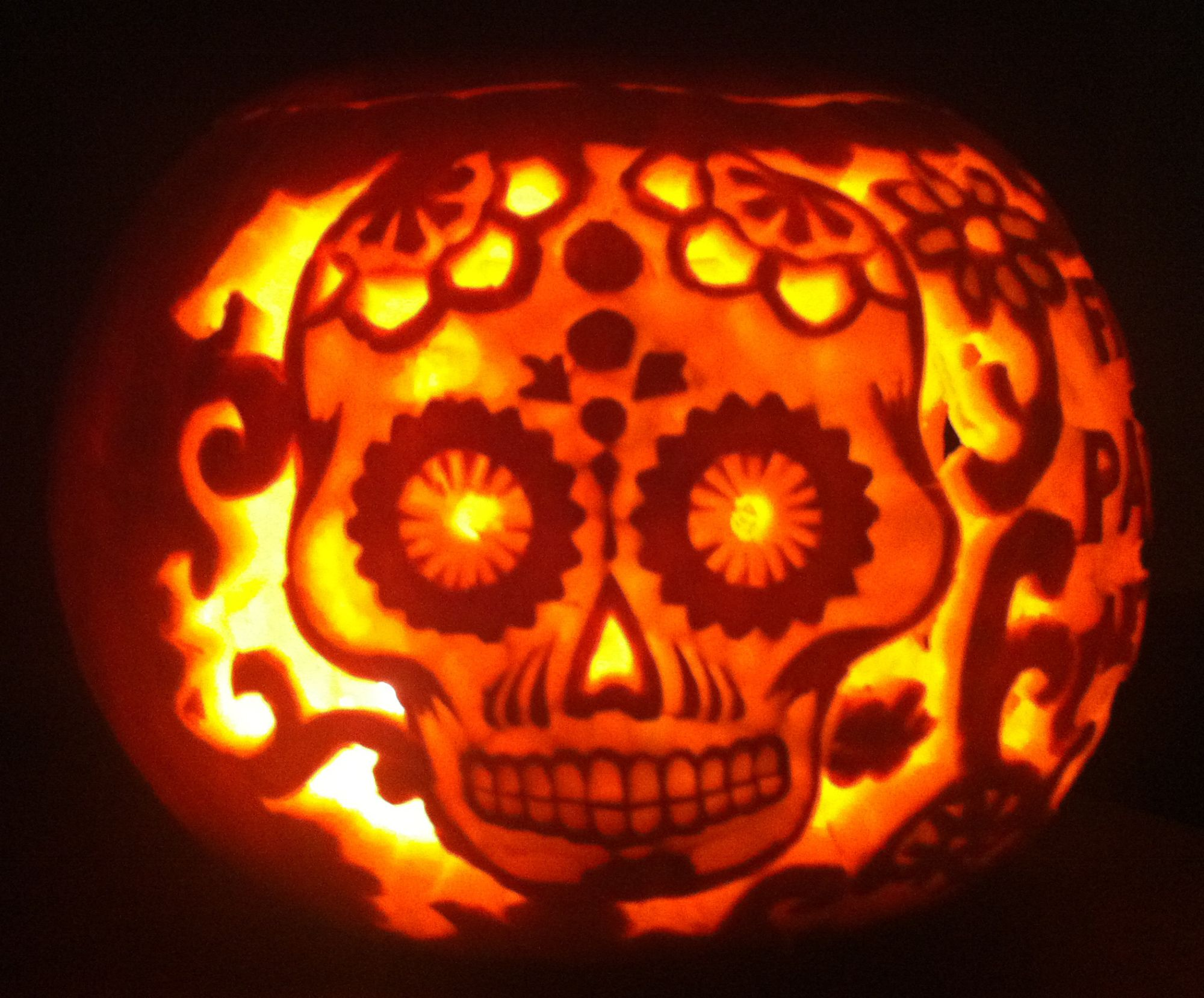 halloween pumpkin carved with day of the dead skull and pattern rh pinterest com day of the dead skull pumpkin carving day of the dead pumpkin carving easy
