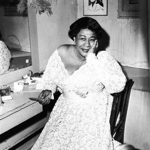 """""""vintageblackglamour:  Ella Fitzgerald in lace and a heart-shaped necklace her dressing room.  """""""