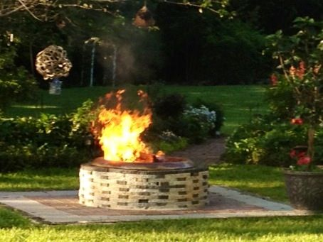 Earthstoneproducts.net   Beautiful 4ft fire pit with copper ring on patio.  The original recycled granite paver company.