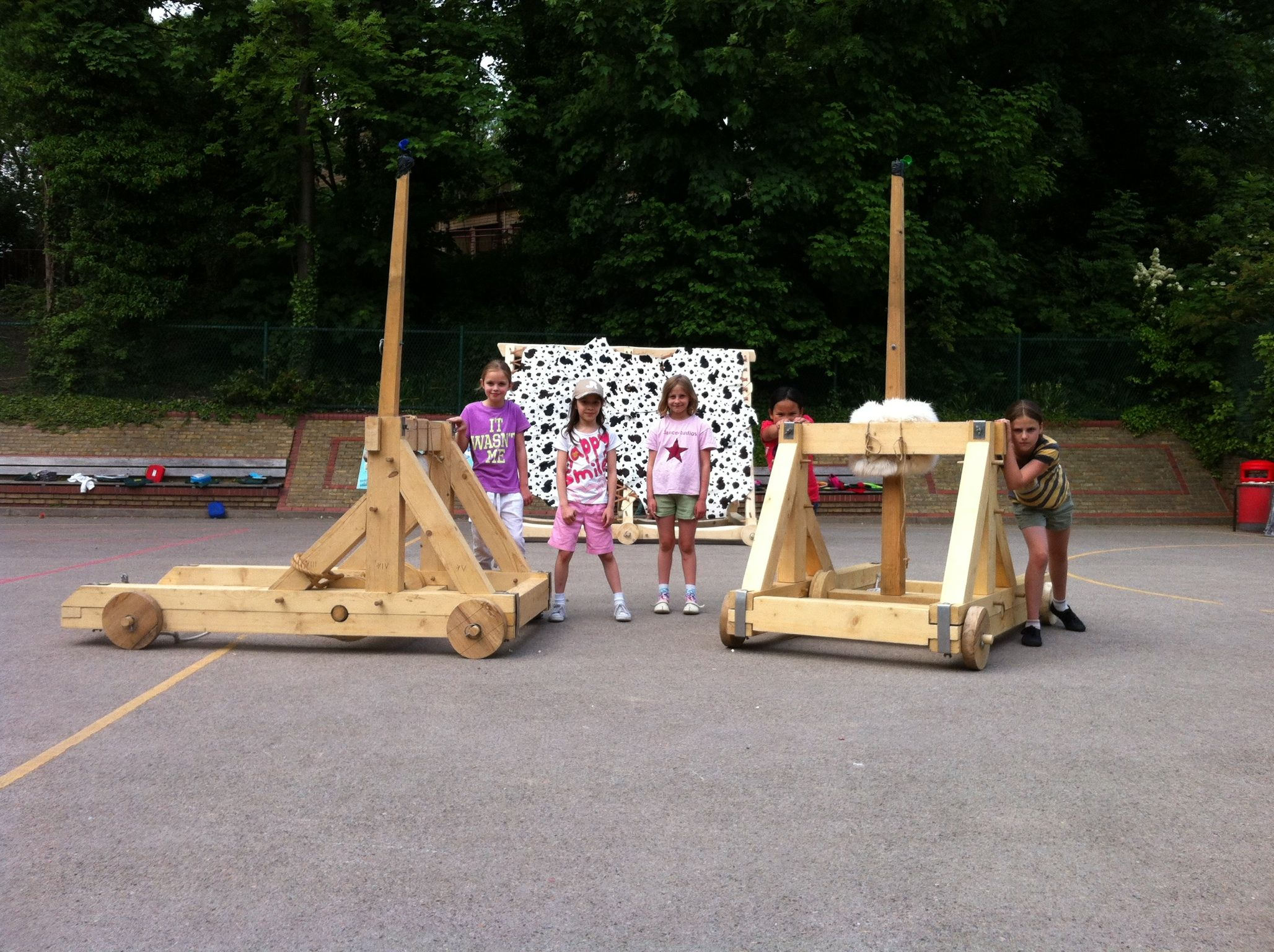 Children build two Onagar catapults and a battering ram in ...