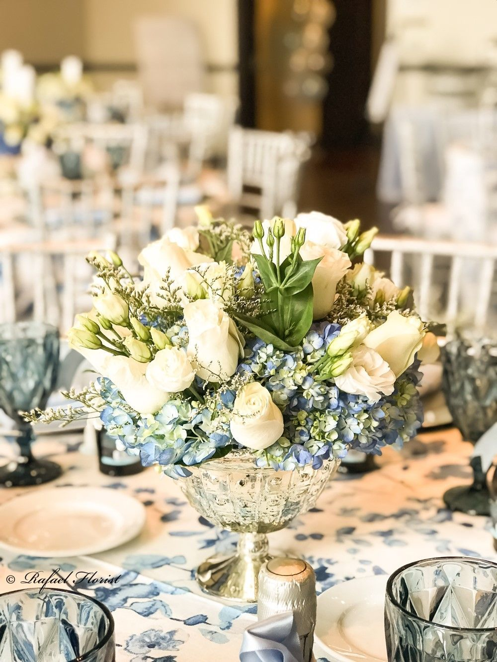 blue and white floral centerpiece with hydrangeas roses and rh pinterest com