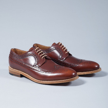 Berwick Brown Lace-up Brogues: Berwick use premium leather from the German tannery of Jon Rendenbach Jr. where the cuts are tanned for a year in oak leaves. After this, the final colouring and patina effect is done by hand so each pair is totally unique.