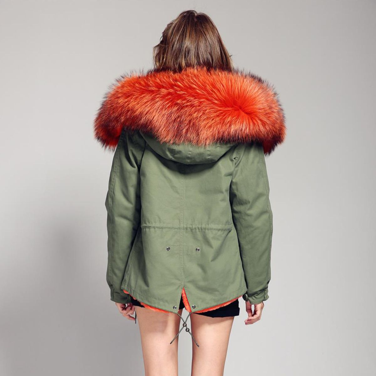 Green parka coat with orange fur hood and faux fur lining ...