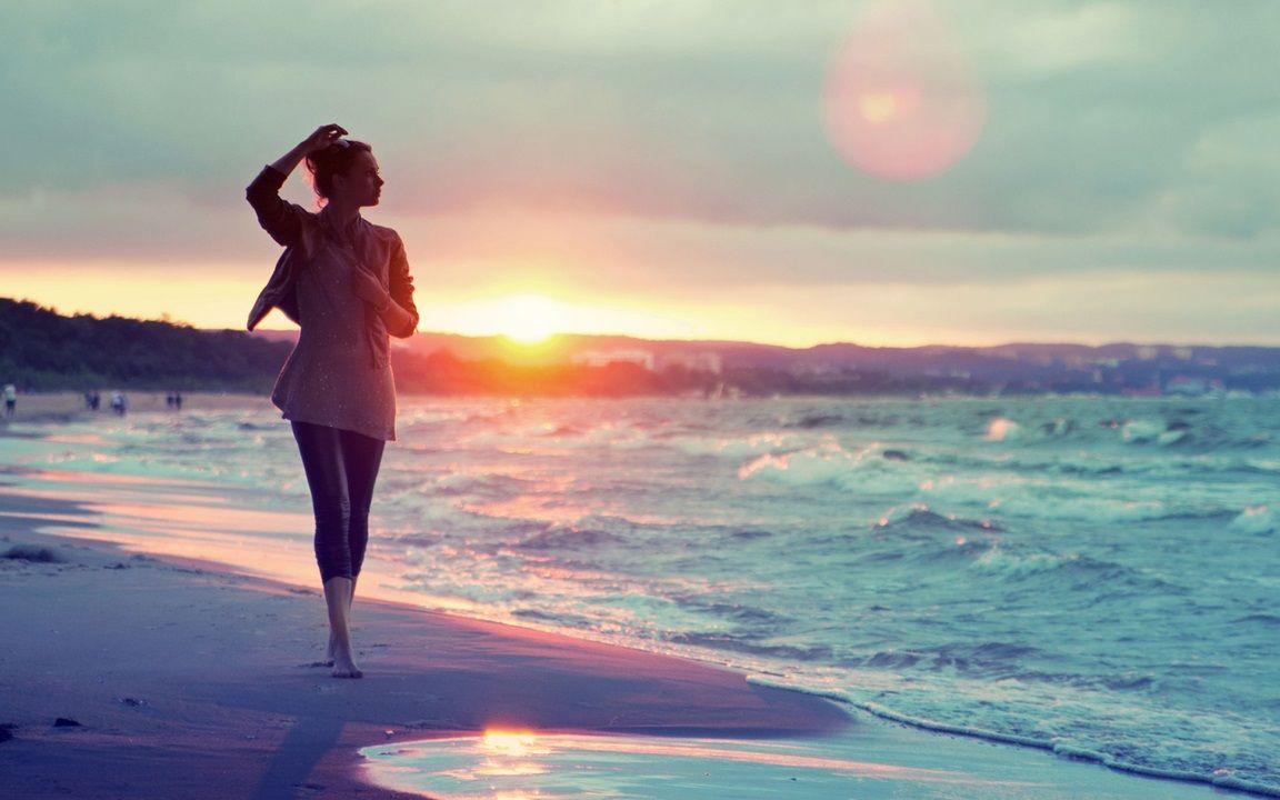 girl walking on the beach at sunset hd wallpaper photograph