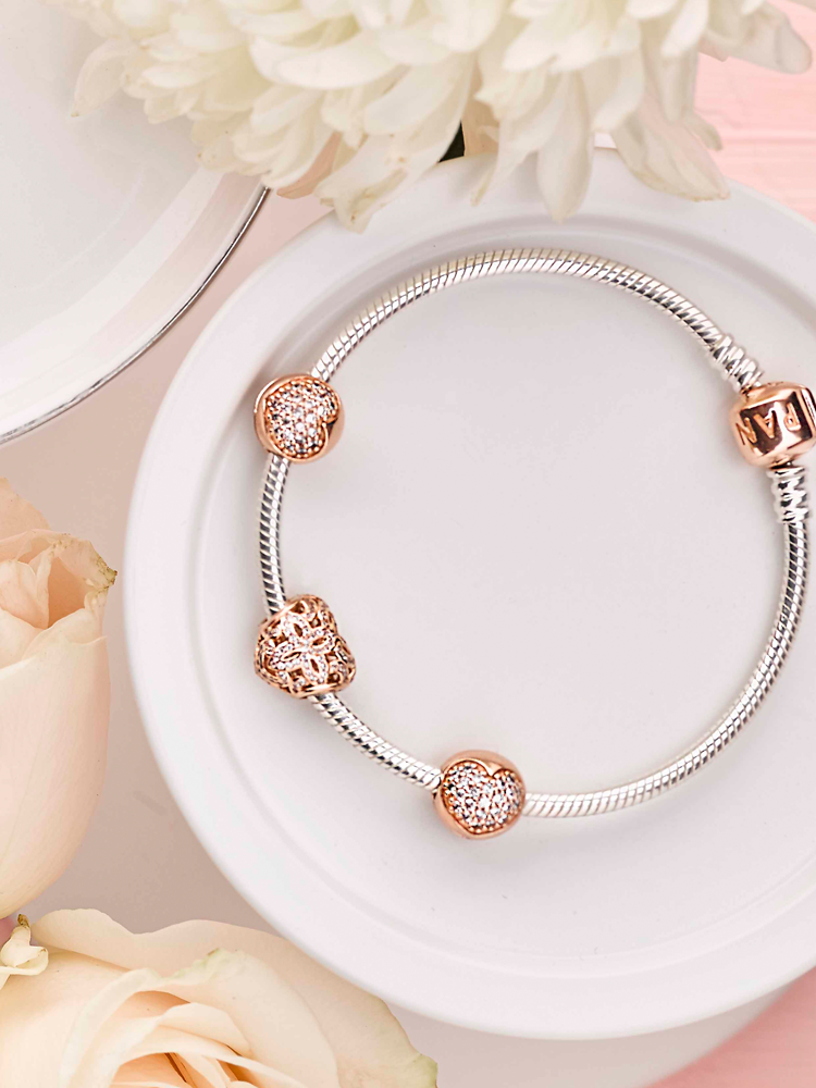 e39f21943 This season, the PANDORA Rose collection presents glittering and timeless  jewellery designs adorned with iconic