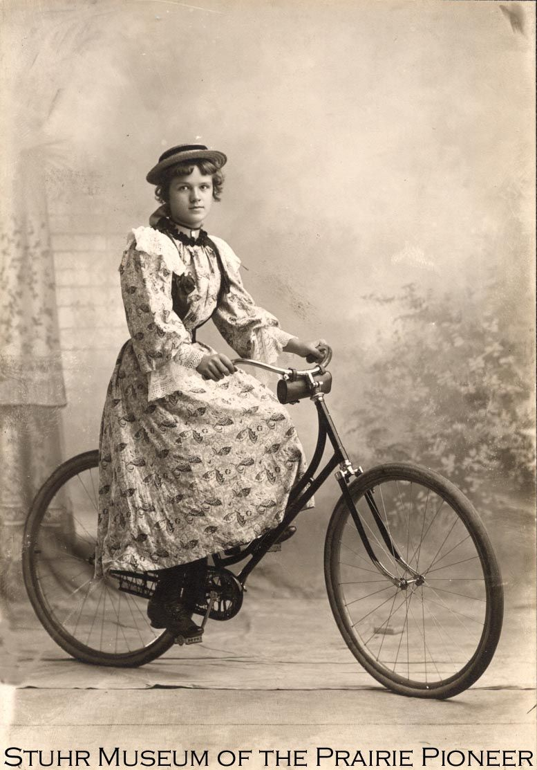 """The voluminous, sweeping skirts of the 1890s were a handicap for women bicycle riders.  Bloomers, which resembled large puffy, knee length trouser, were far easier to ride in, but were considered quite scandalous when first introduced.  The sight of a bloomer-clad woman on streets of Grand Island, according to the Independent, """"excited considerable comment and attracted a great deal of attention."""" A movement built around Annie"""