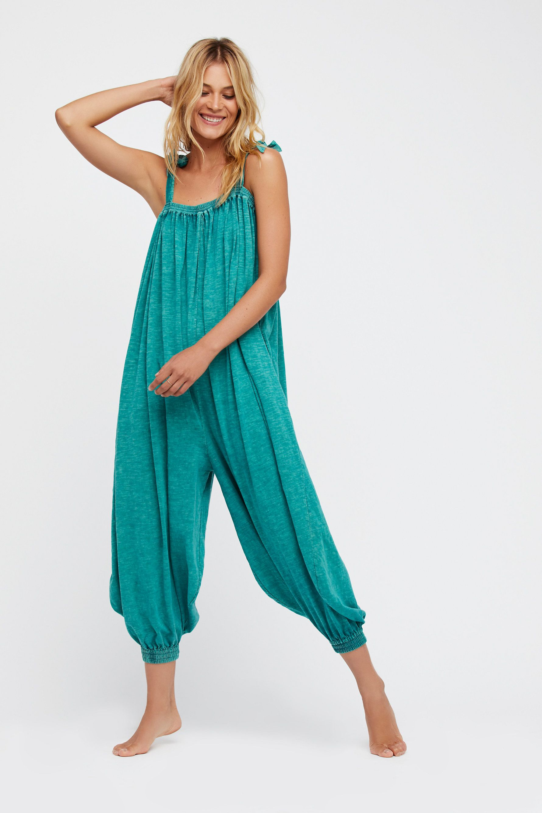 Take It Easy Romper | Oversized, shapeless romper featuring adjustable tie straps and a comfortable cotton fabrication for an effortless look.    * Side pockets   * Elastic at the neckline and ankles for an easy fit