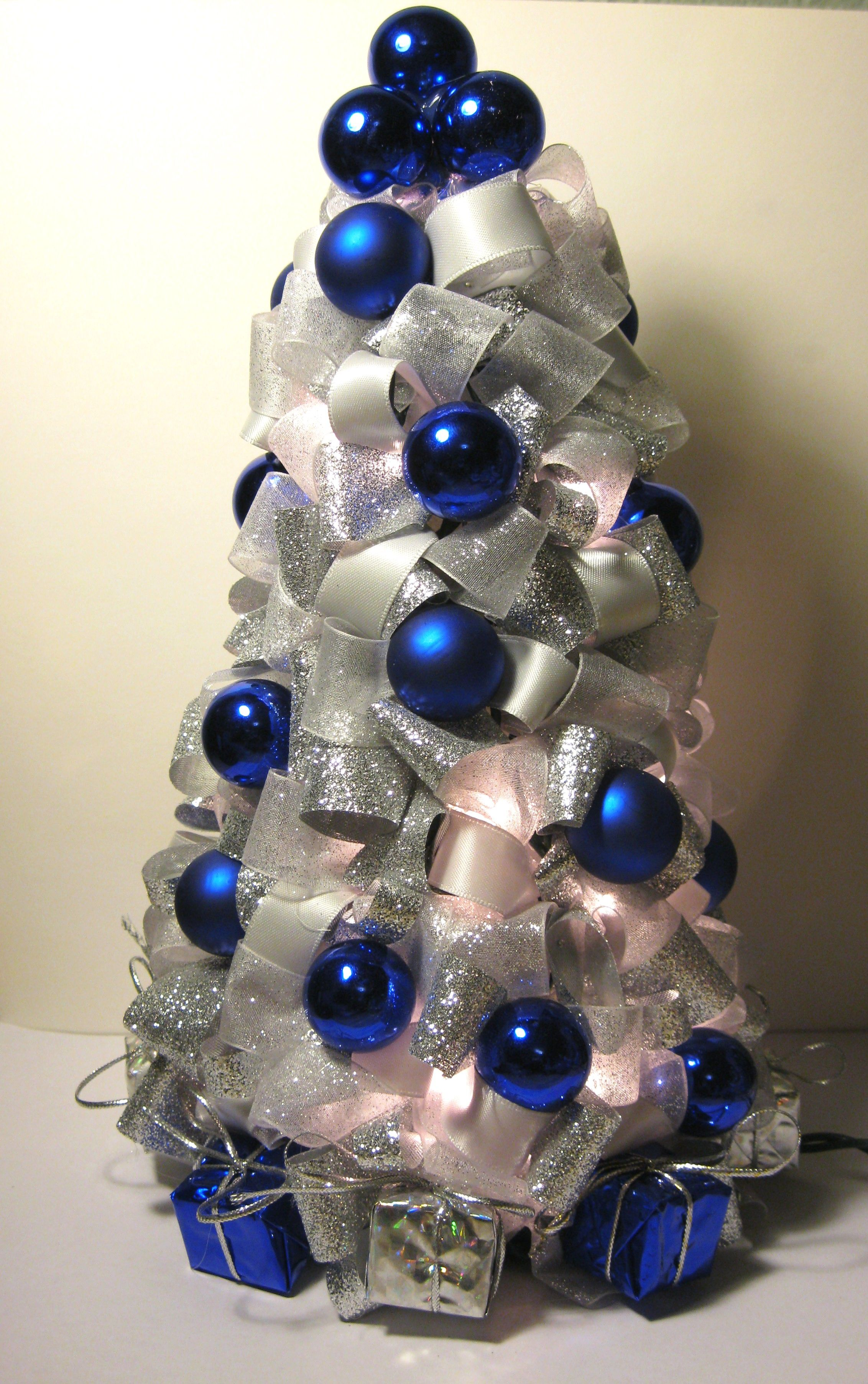 Silver blue and white Christmas tree made with ribbon It also
