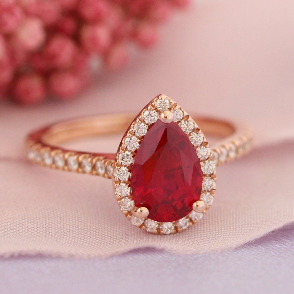 Pear ruby engagement ring in rose gold halo diamond band xmm
