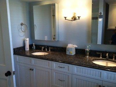 Master bath w/ blue pearl granite, two sinks, custom tiled ...