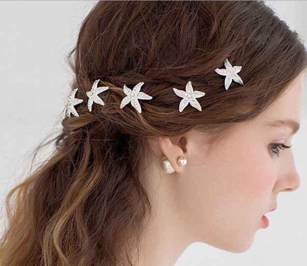 Add some rhinestone starfish to your hair.