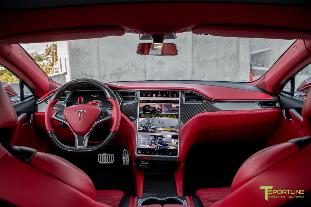 Tesla model s with custom interior in bentley red and gloss carbon fiber