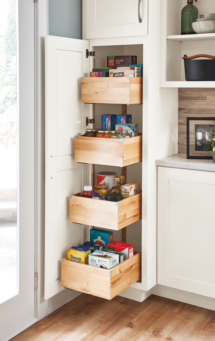 A tall pantry with deep drawers makes achieving a well-organized kitchen a breeze.  Click for more of our favorite kitchen storage solutions! #kitchenpantrydesign