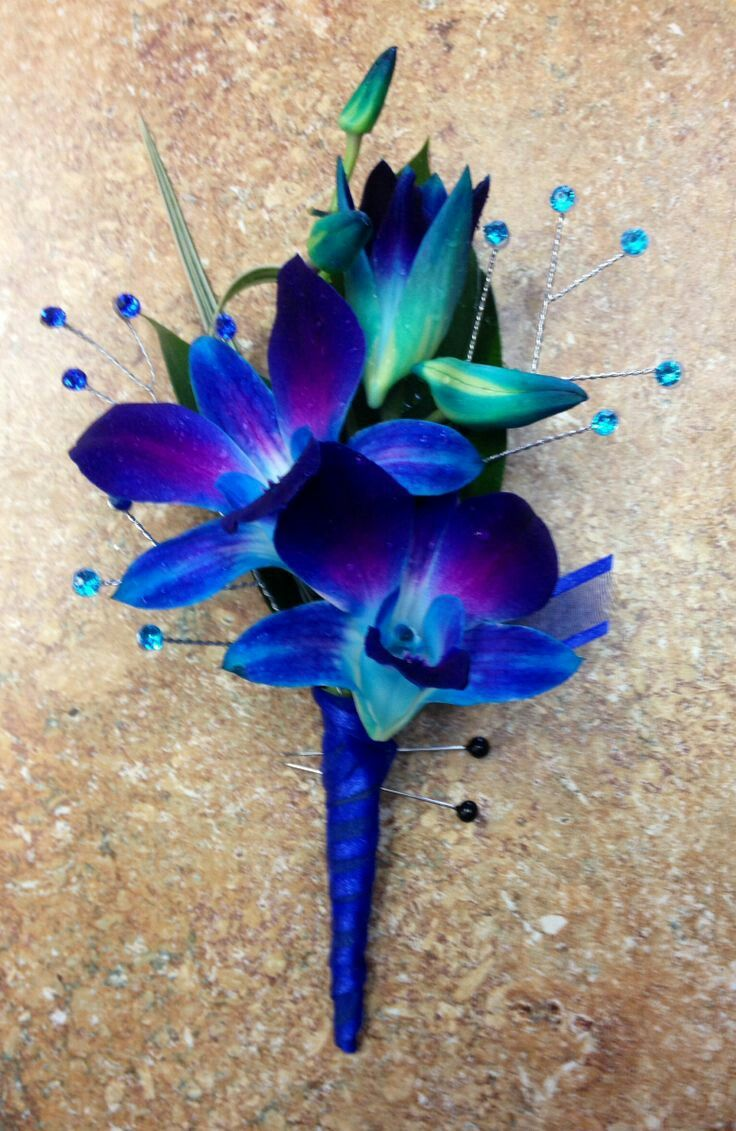 Blue dendrobium orchids with spray gems for a pinon lapel