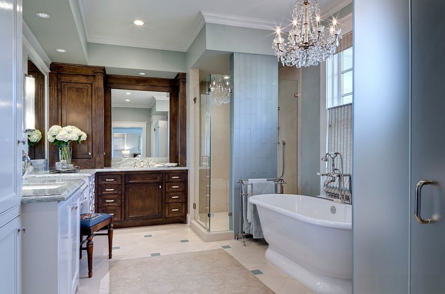 Classic glass chandelier shines in the traditional bathroom