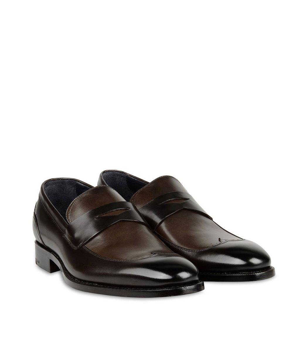 ERMENEGILDO ZEGNA SHOES Beautifully accented with tonal brown leather  uppers classic brogue detail and