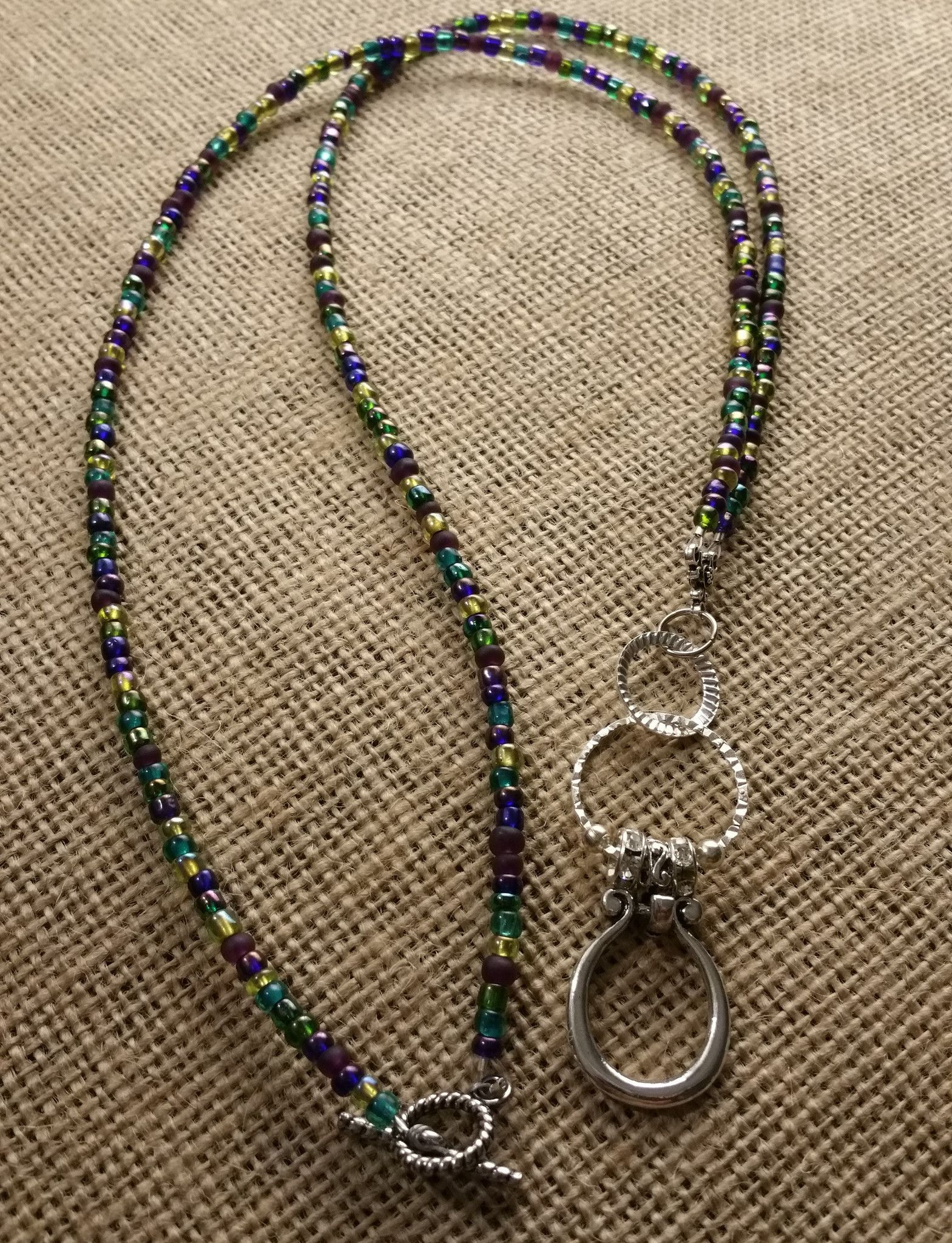 f7833cc13420 Folding Style Functional Necklace Eyeglass Holder in Peacock with Silver  Links and Toggle Clasp