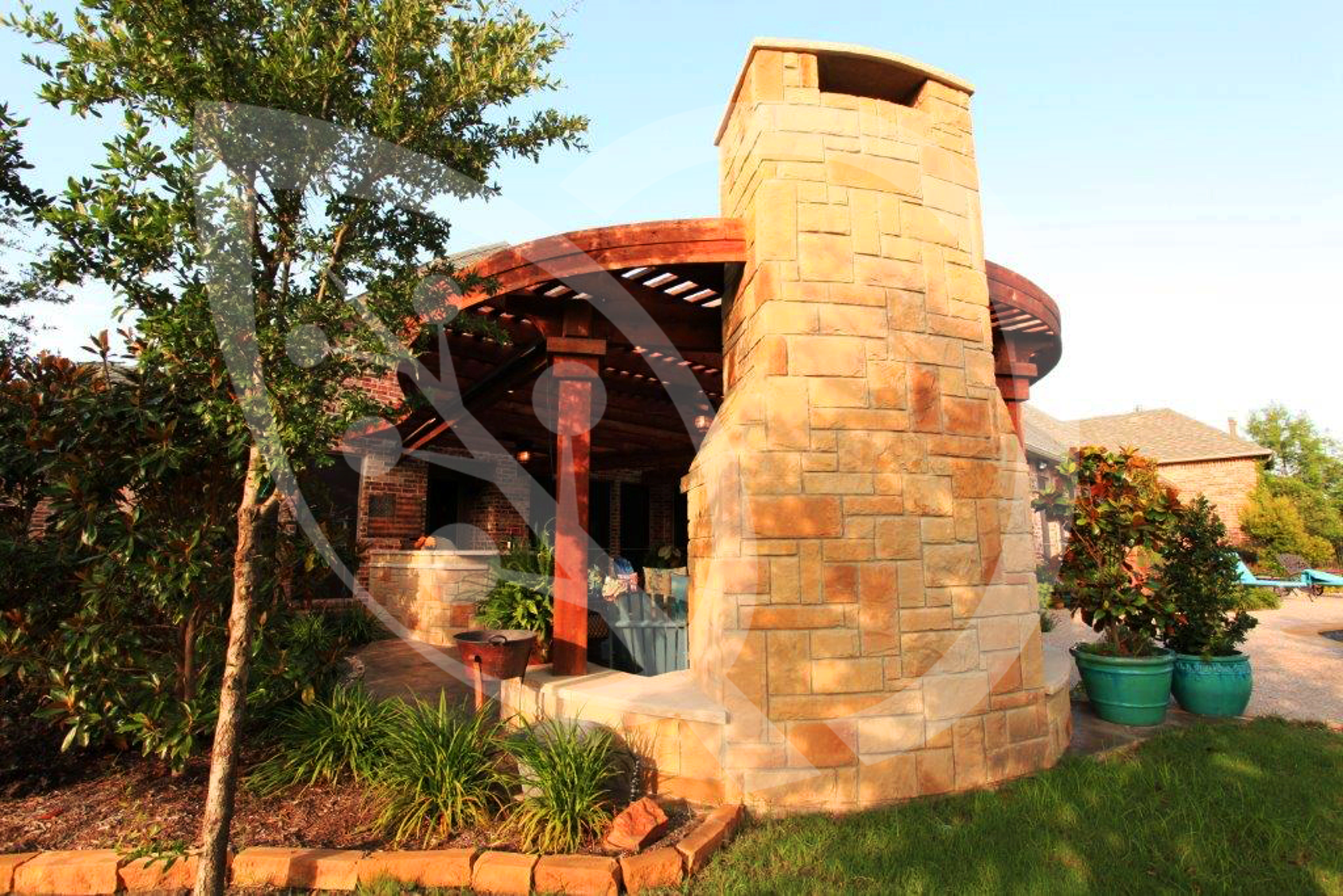 Stunning architectural design with stone by Outdoor Signature.