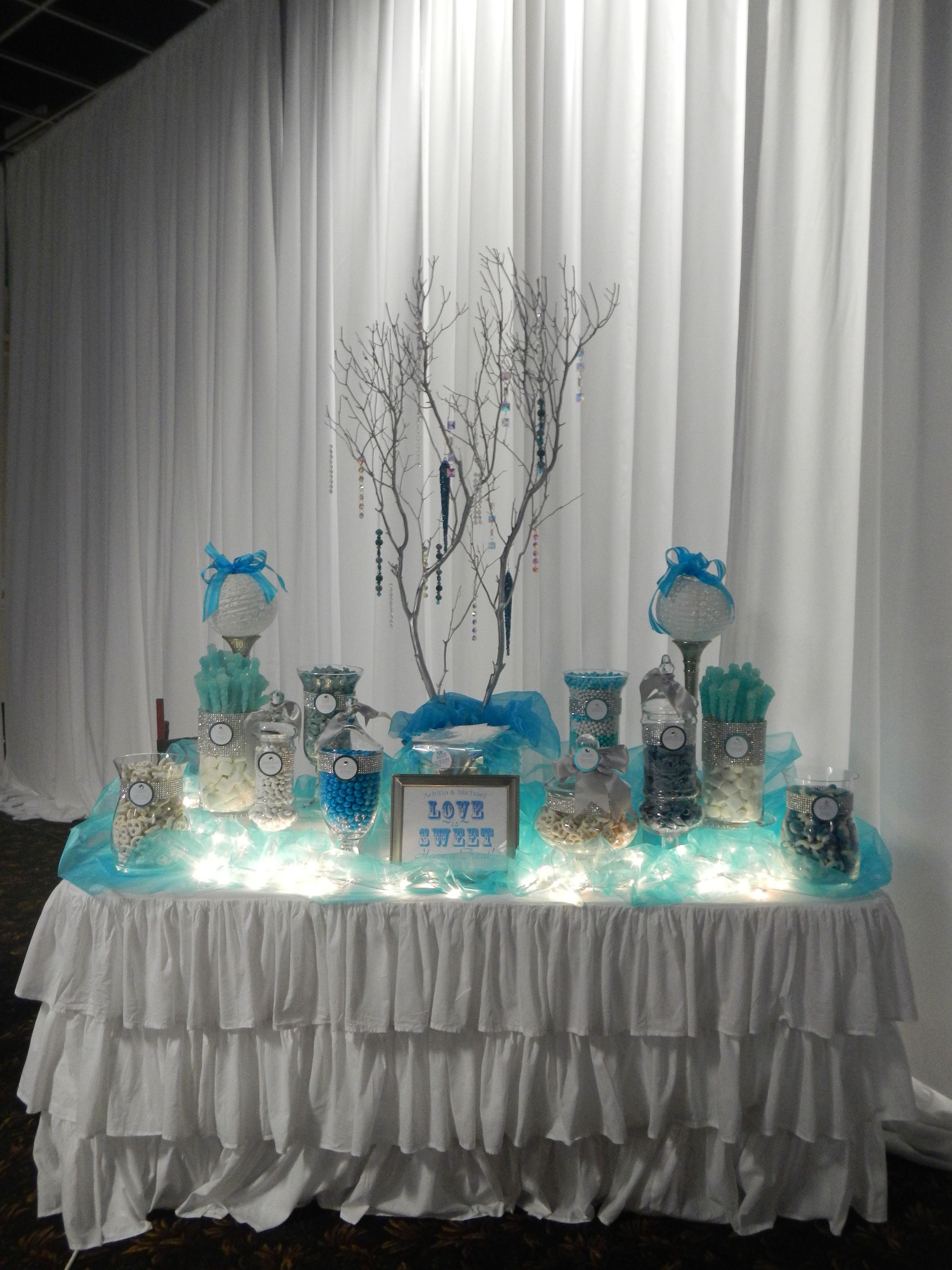 wedding candy buffet by sugarpalooza using tea lights or christmas lights to highlight the table