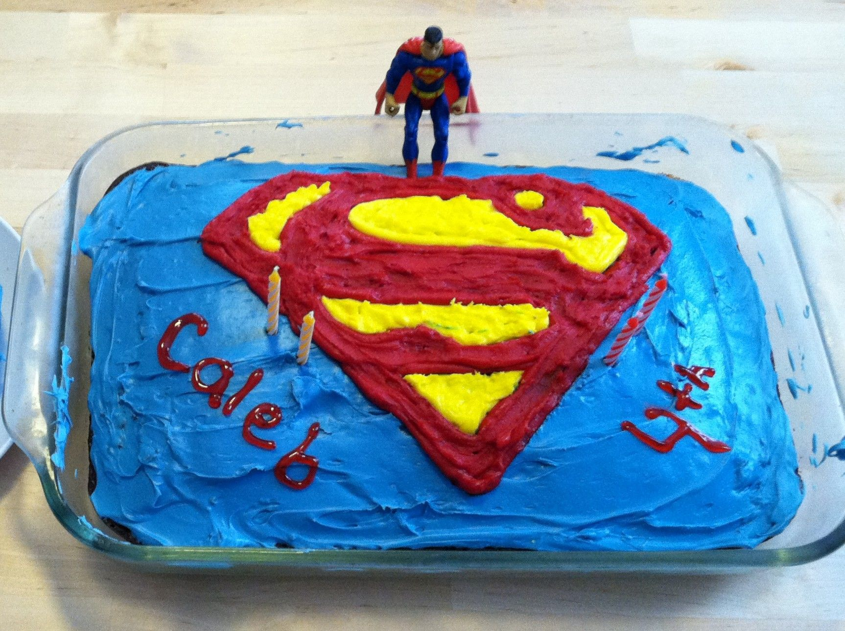 Easy superman cake I created a stencil using waxed paper then