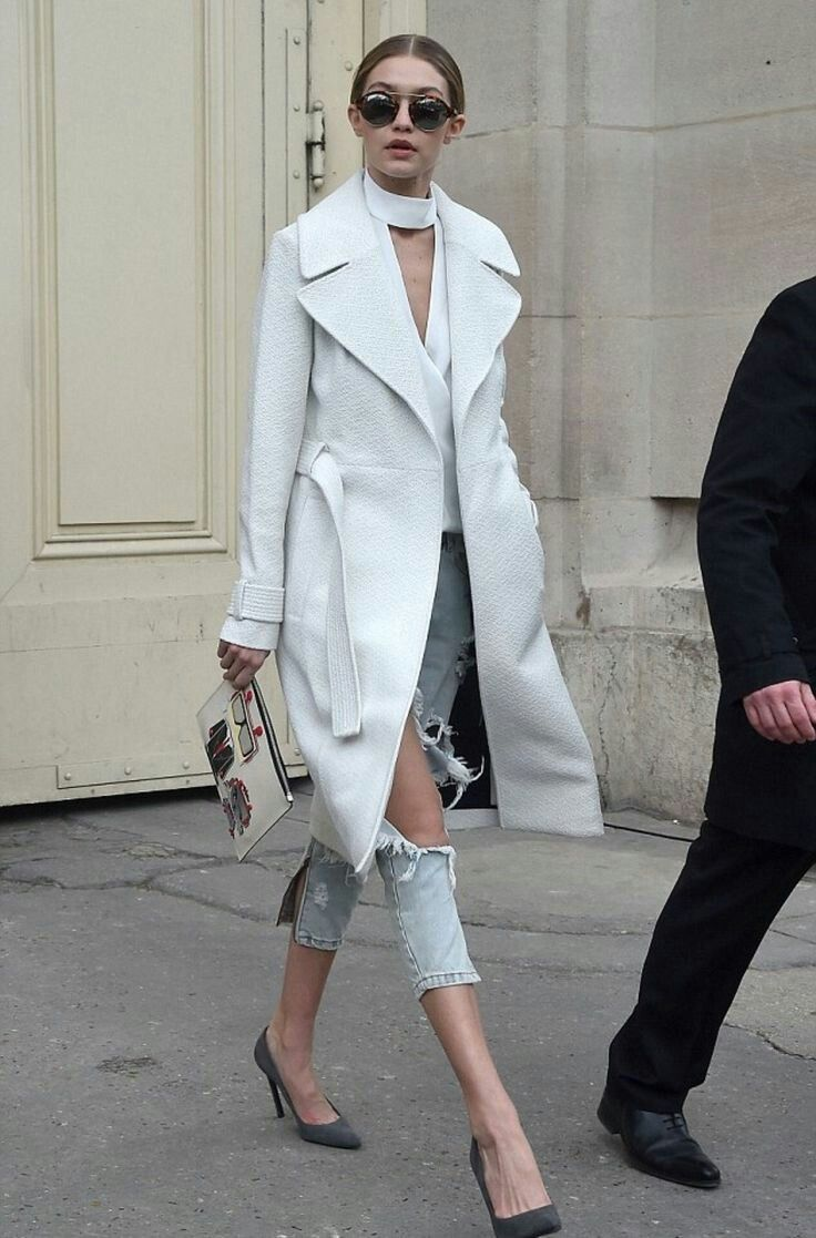Gigi Hadid street style with white coat and ripped jeans. #gigihadid  #celebrity…