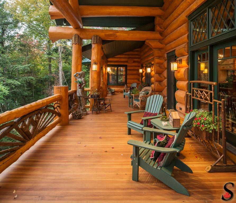 Log home porch by sitka log homes make mine rustic for Log cabin porch