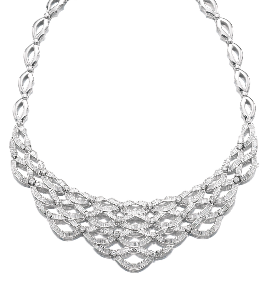 DIAMOND NECKLACE.  Designed as a series of graduated swags set with brilliant-cut and baguette diamonds, inner circumference approximately 405mm.