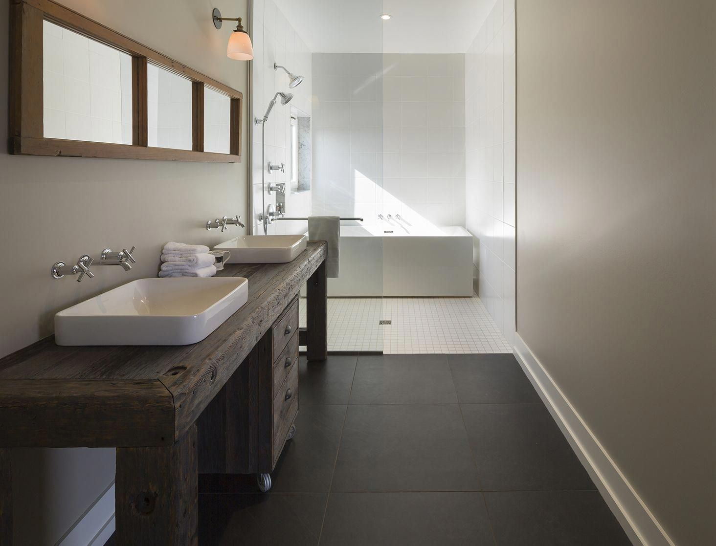 The master bathroom features sinks and fixtures by Kohler