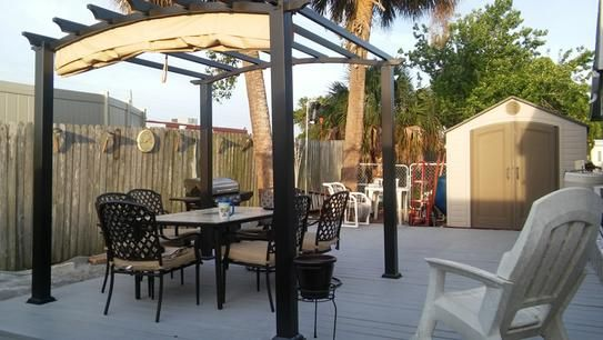 Hampton Bay 9 Ft X 9 Ft Steel And Aluminum Arched Pergola With Retractable Canopy Gfm00469a The Home Depot Canopy Outdoor Pergola Patio Canopy