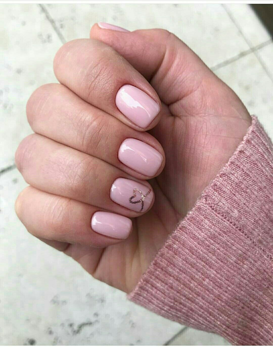Pale pink nails with a gold heart accent nail nails in